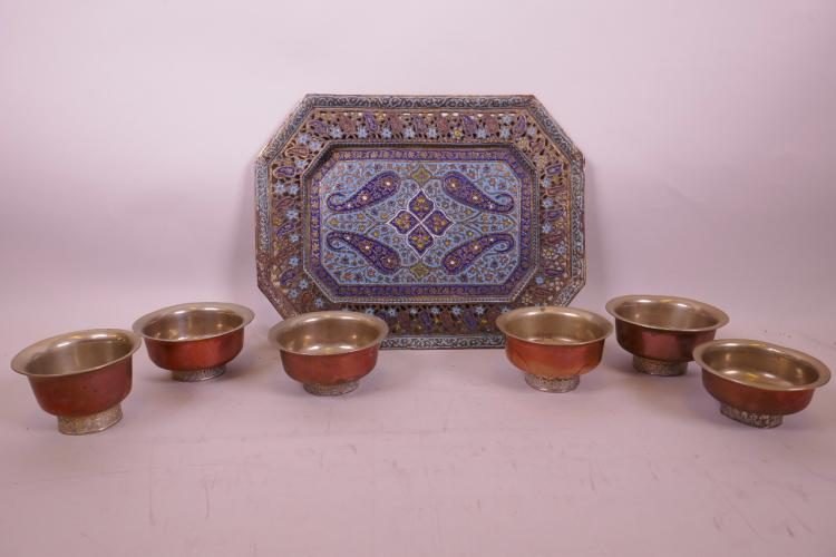 A KASHMIRI ENAMELLED BRONZE TRAY DECORATED WITH A PAISLEY PATTERN, TOGETHER WITH SIX INDIAN WHITE METAL AND COPPER THALI BOWLS, TRAY 10