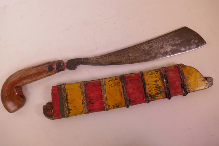 AN EARLY INDONESIAN IMALAY PARANG WITH LAMINATED HANDLE AND PAINTED WOODEN SCABBARD