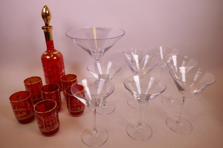 A BOHEMIAN GILT OVERLAID SET OF GLASS DECANTER AND SIX TUMBLERS, TOGETHER WITH EIGHT CLEAR GLASS MARTINI GLASSES AND SIMILAR GIANT GLASS