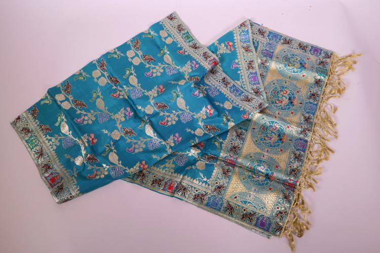 AN INDIAN BLUE SILK SHAWL WITH SILVER GILT THREAD DECORATION OF ELEPHANTS, TIGERS, BIRDS AND FLOWERS, 20