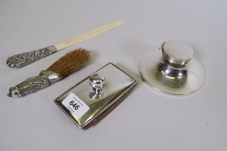 A HALLMARKED SILVER INKWELL (LINER A/F), A SILVER BLOTTER, A SILVER AND IVORY PAGE TURNER (TIP A/F) AND A CRUMB BRUSH IN THE FORM OF A DEER'S FOOT