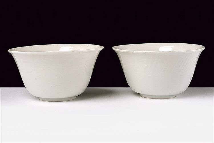 An exceptional pair of blanc-de-Chine porcelain cups with secret decoration