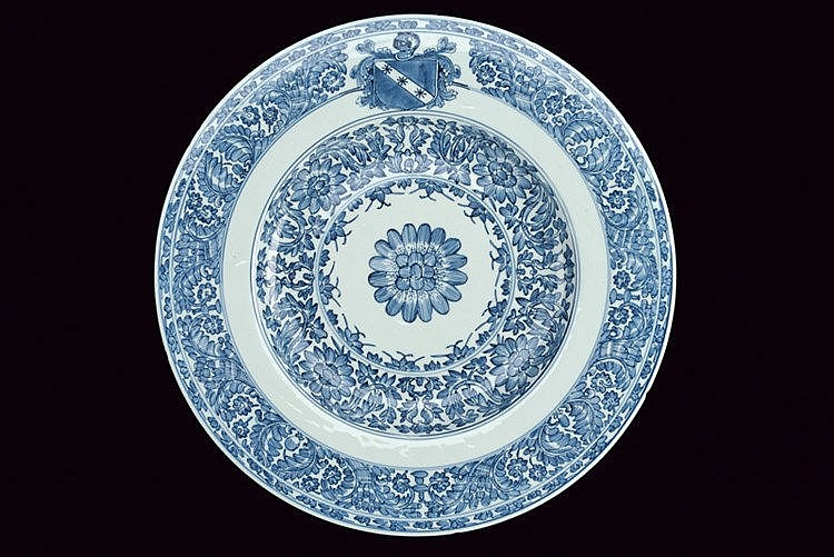 An important and large armorial plate in blu and white porcelain of the Portuguese Indian Companies