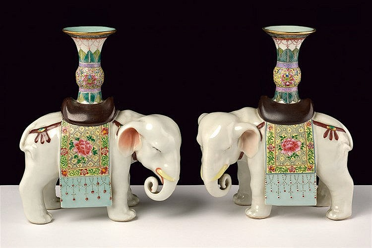 A fine pair of famille rose porcelain elephant figures
