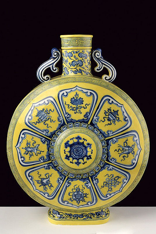 A big yellow ground bajixiang porcelain moon flask