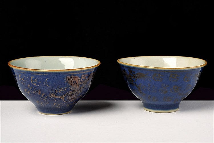 A fine pair of powder blu and gold porcelain cups