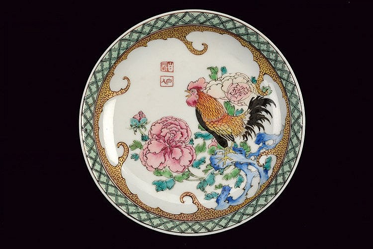 A stunning and rare famille rose export saucer