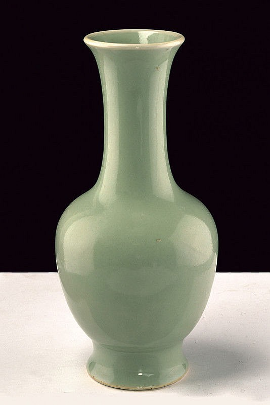 A celadon glazed porcelain baluster vase