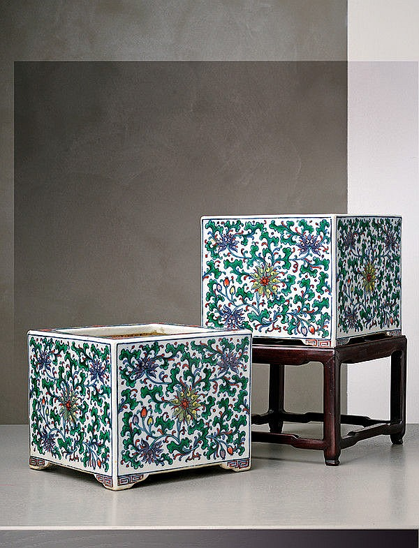 An important and rare pair of doucai square porcelain jardinieres on stands