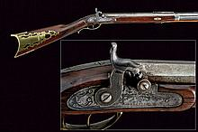 A percussion Kentucky rifle, dating: mid-19th Cent