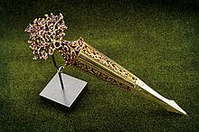 A Sarpech in gold and rubies , dating: circa 1900,