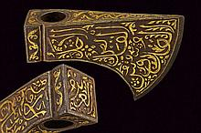 An axe head with gold inscriptions, dating: circa