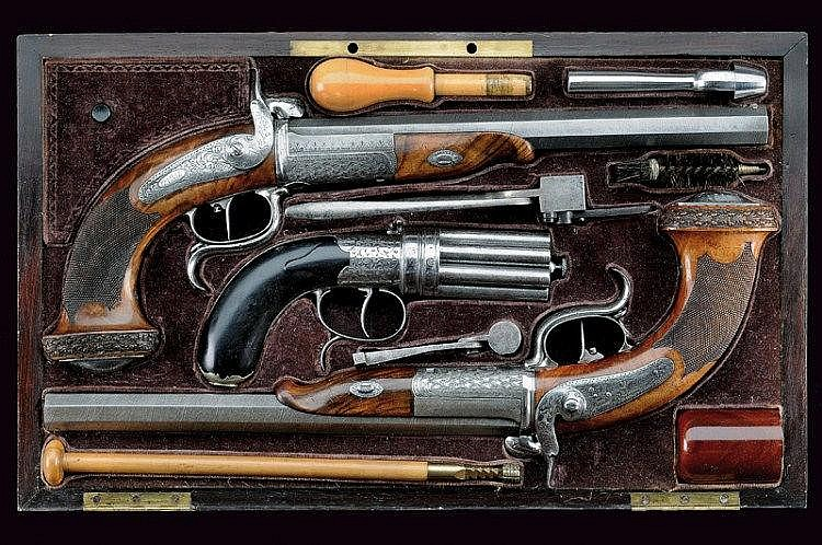 A rare cased pair of pin-fire Beringer pistols and a eight-shot Hermand pepperbox revolver
