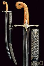 A silver mounted shamshir