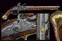 A flintlock pistol with grotesque engravings