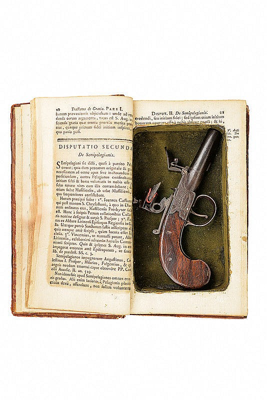 A flintlock pocket pistol hidden in a book