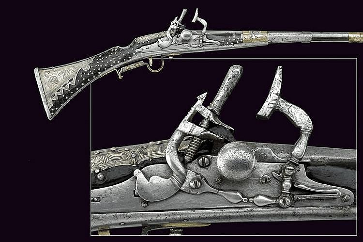 A silver mounted flintlock gun