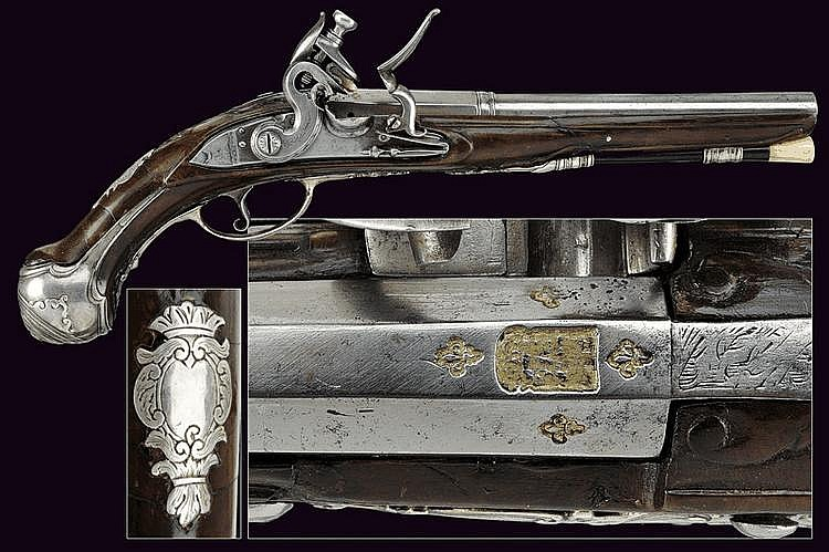 A silver mounted flintlock pistol