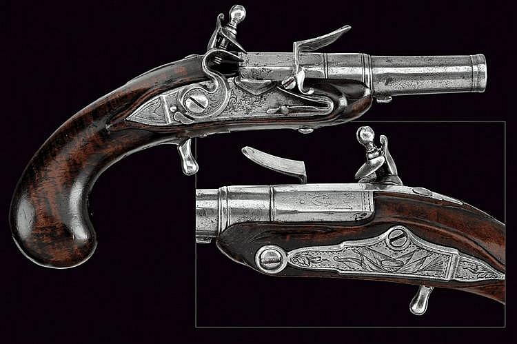A flintlock travelling pistol