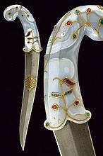 A beautiful kandshar with decorated stone hilt