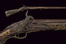A long percussion-converted roman lock gun