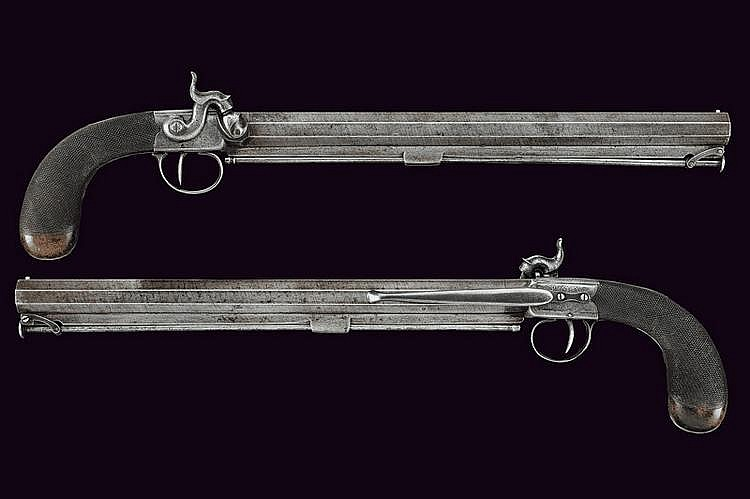 A pair of percussion pocket pistols with long barrels