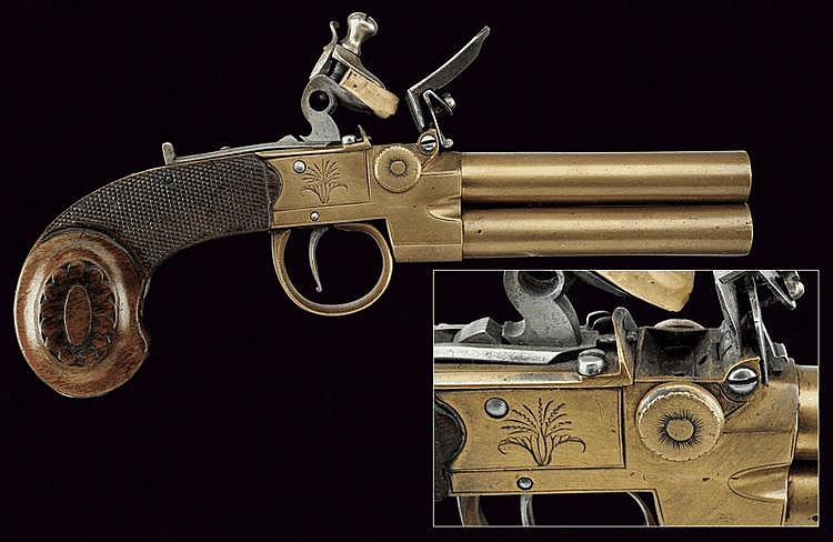 A double-barrelled bronze matchlock pistol