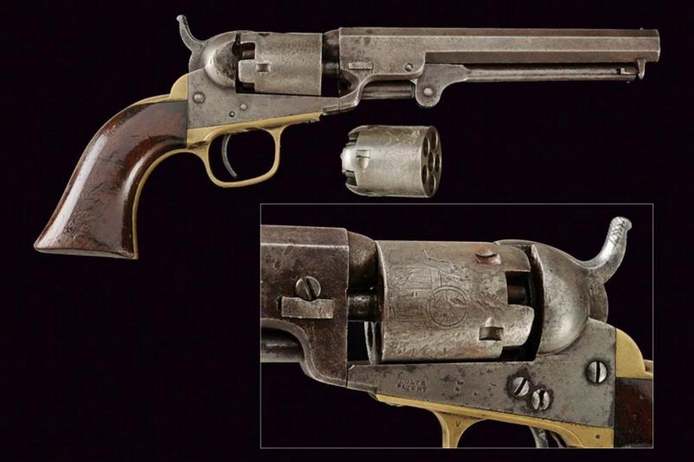 A Colt Model 1849 Pocket Revolver with second cylinder