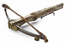 An important and beautiful crossbow, dating: early 17th Century, provenance: Germany, dating: early 17th Century, provenance: Germany, Heavy, iron bow decorated with tassels and compete with all its original ropes; German-style tiller made of wood