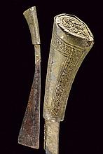 A punal, dating: circa 1900, provenance: Indonesia, dating: circa 1900, provenance: Indonesia, Single-edged blade widening toward the tip, grip with white, metallic covering and engraved with floral motifs. , length 34.5 cm.