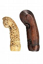 A lot of two kris hilts, dating: circa 1900, provenance: Giava, dating: circa 1900, provenance: Giava, One for a small kris, presumably for woman, made of bone and richly sculpted with floral motifs; the other one made of wood, slightly carved with