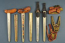 A lot of kris scabbards, dating: circa 1900, provenance: Indonesia, dating: circa 1900, provenance: Indonesia, Two with warangka and pendok, two gandar with leather pocket and pendok, two gandar with pendok. Together with two pockets decorated with
