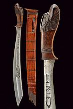 A rare parang, dating: late 19th Century, provenance: Giava, dating: late 19th Century, provenance: Giava, Heavy, single-edged blade enlarged toward the oblique tip, with wide fuller at the center and a thin groove at the back; featuring the writing