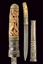 A dha (knife), dating: late 19th Century, provenance: Burma, dating: late 19th Century, provenance: Burma, Slightly-curved, single-edged blade; bonegrip, richly sculpted and pierced with a deity, snakes and floral motifs; partially colored and