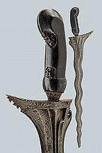 A kris, dating: circa 1900, provenance: Giava, dating: circa 1900, provenance: Giava, Straight, undulated, double-edged blade made of very fine pamor, carved and grooved at the base; wooden grip, slightly sculpted with floral motifs, metallic mendak.