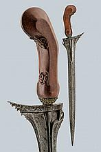A kris, dating: circa 1900, provenance: Giava, dating: circa 1900, provenance: Giava, Straight, smooth, double-edged blade with raiser at the center, carved and grooved at the base; woode ngrip, slightly carved with floral motifs. Brass mendak. ,