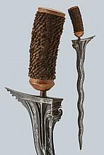 A kris, dating: circa 1900, provenance: Bali, dating: circa 1900, provenance: Bali, Straight, undulated, double-edged blade made of fine, smooth pamor, carved and grooved at the base; wooden grip with fiber-covering. Missing scabbard. , length 53 cm.