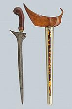 A kris, dating: 19th Century, provenance: Giava, dating: 19th Century, provenance: Giava, Straight, smooth, double-edged blade made of fine pamor, grooved and carved at the base; wooden grip, slightly carved with floral motifs, brass mendak; wooden