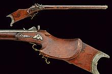 A percussion target rifle, dating: mid-19th Century, provenance: Austria, dating: mid-19th Century, provenance: Austria, Heavy, rifled, octagonal, 10 mm cal. barrel marked 'W.W.', with brass foresight; tang with peep sight; simple lock with opposite