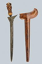 A kris, dating: circa 1900, provenance: Giava, dating: circa 1900, provenance: Giava, Straight, smooth, double-edged blade made of fine pamor; grooved and carved with two figures at the base; bone grip, richly sculpted and pierced with floral motifs,