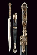 A gaucho's knife, dating: circa 1900, provenance: Argentina, dating: circa 1900, provenance: Argentina, Long, straight, single-edged blade; silver grip, sculpted and engraved with floral motifs; leather scabbard with silver mounts, hook with horse