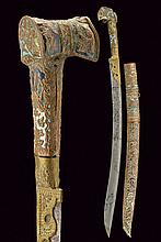 An interesting yatagan with enameled decoration, dating: 19th Century, provenance: Turkey, dating: 19th Century, provenance: Turkey, Slightly-curved, single-edged blade of typical shape, with groove at the back; brass base and ring-nut, decorated