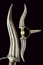 A bichwa, dating: circa 1900, provenance: India, dating: circa 1900, provenance: India, Iron, central grip with small, bone grip scales; two, lateral, curved, double-edged blades with slightly-strengthened and ribbed tips and double fuller at the