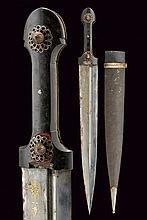 A kindjal, dating: 19th Century, provenance: Caucasia, dating: 19th Century, provenance: Caucasia, Wide, straight, double-edged blade with asymmetrical grooves, decorated with gold floral motifs on one side and featuring two birds; grip with black,