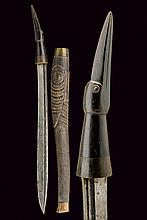 An interesting dagger, dating: circa 1900, provenance: Indonesia, dating: circa 1900, provenance: Indonesia, Strong, straight, single-edged blade with groove at the back. Brown, horn grip carved in the shape of a bird head and with metallic ring-nut;