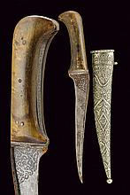 A pesh-kabz, dating: 19th Century, provenance: India, dating: 19th Century, provenance: India, Curved, single-edged blade with 'T'-back, engraved with floral motifs at the base; grip with band decorated en suite and featuring horn grip scales; wooden