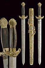 A double Jian (sword), dating: late 19th Century, provenance: China, dating: late 19th Century, provenance: China, Straight, double-edged blade; brass mounts, quillons with stylized, dragon head, pommel engraved with floral motifs; horn grips. Kept