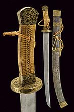 A sabre (dao), dating: late 19th Century, provenance: China, dating: late 19th Century, provenance: China, Wide, slightly-curved, single-edged blade with double fuller at the back; brass hilt, richly engraved and partially pierced with dragons and
