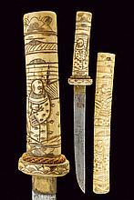 A bone mounted tanto, dating: circa 1900, provenance: Japan, dating: circa 1900, provenance: Japan, Simple, single-edged blade with brass habaki; bone grip and saya, carved and engraves with figures, bridges and floral motifs., length 34 cm.