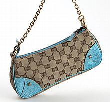 Gucci 25 cm monogram canvas and leather baguette